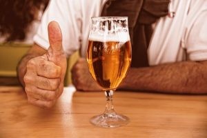 Beer with a new Dad giving thumbs up