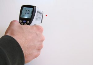 Man holding digital thermometer