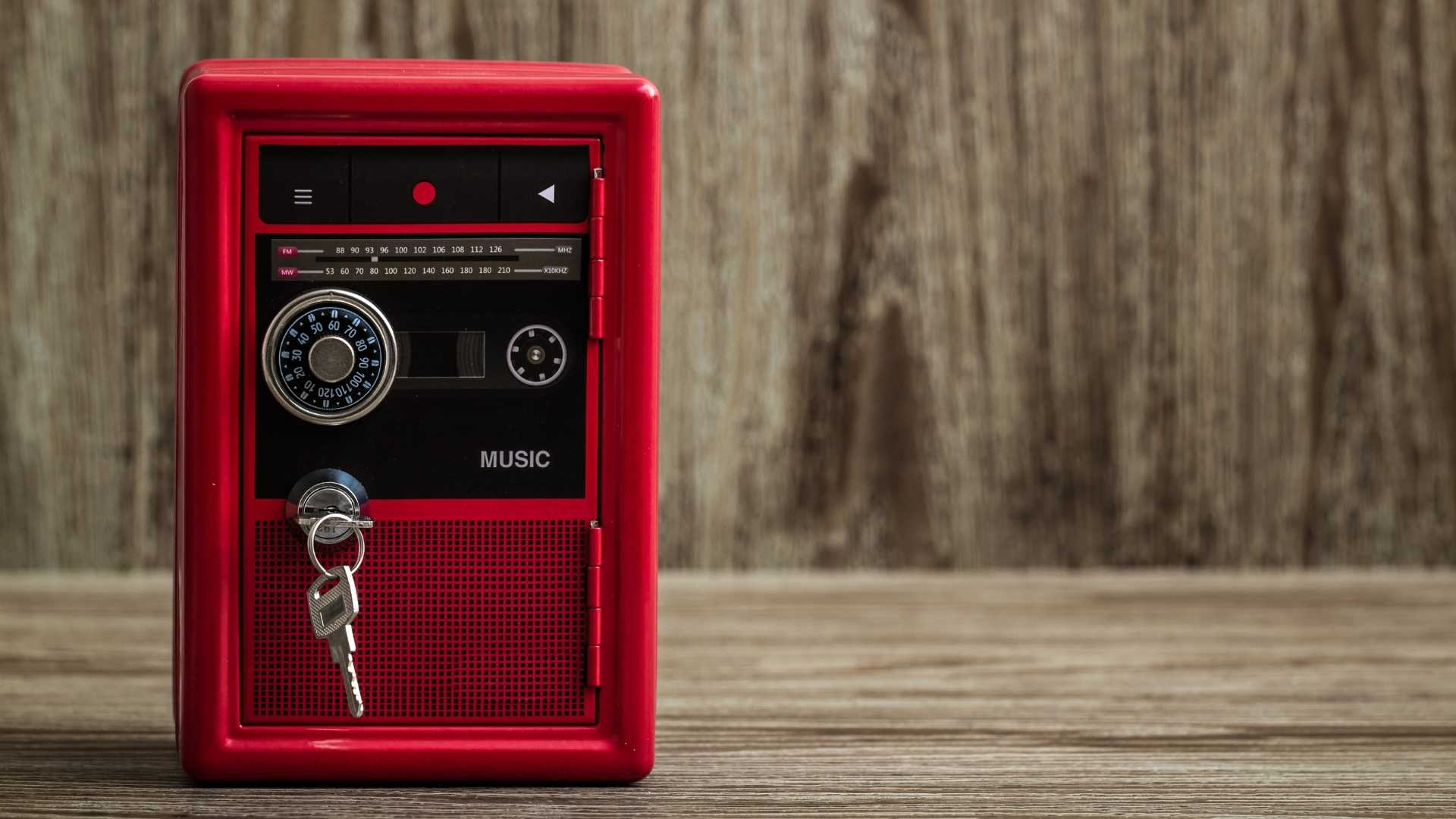 red musical toy with a key and lock