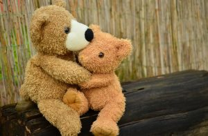 two teddy bears cuddling, comforting