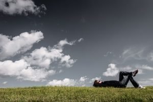 Man relaxing, grass field