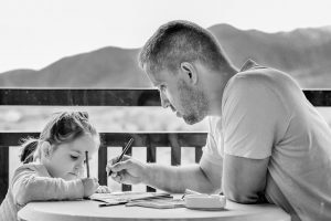 Dad teaching daughter