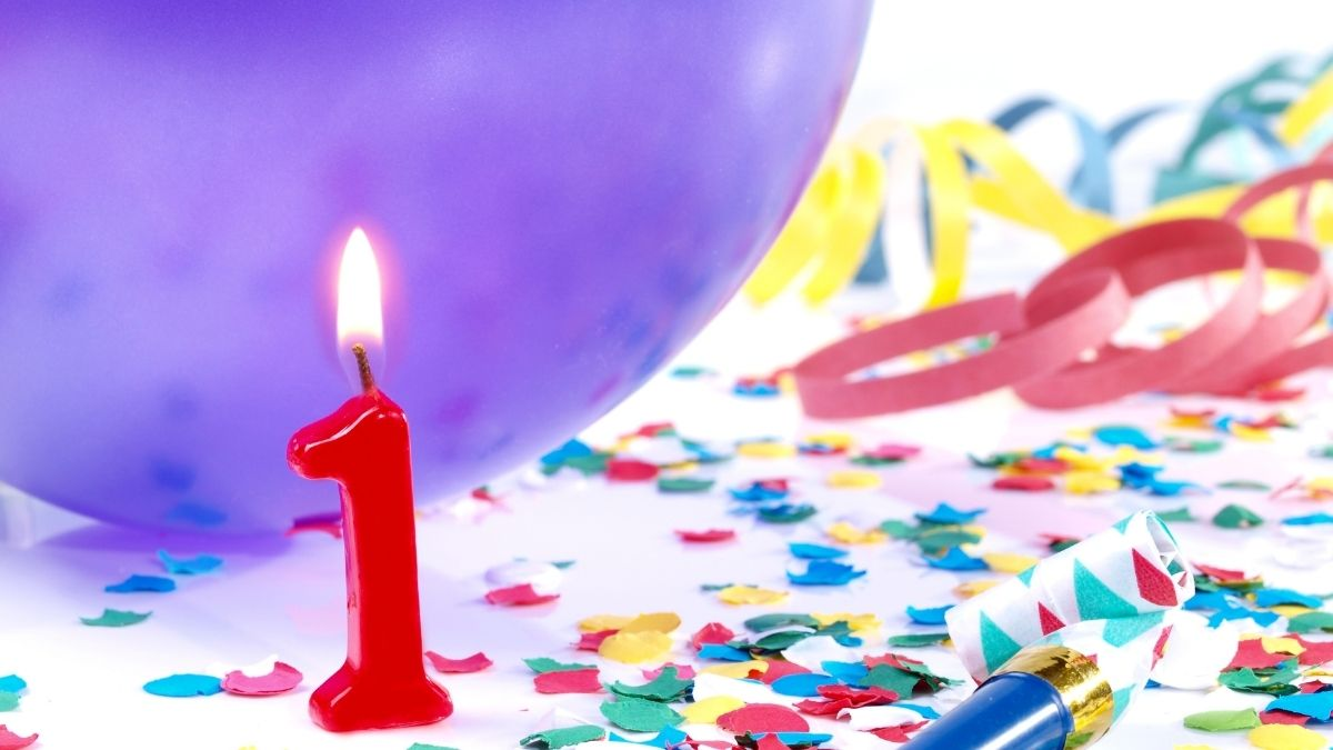 1 candle with balloon and other party objects