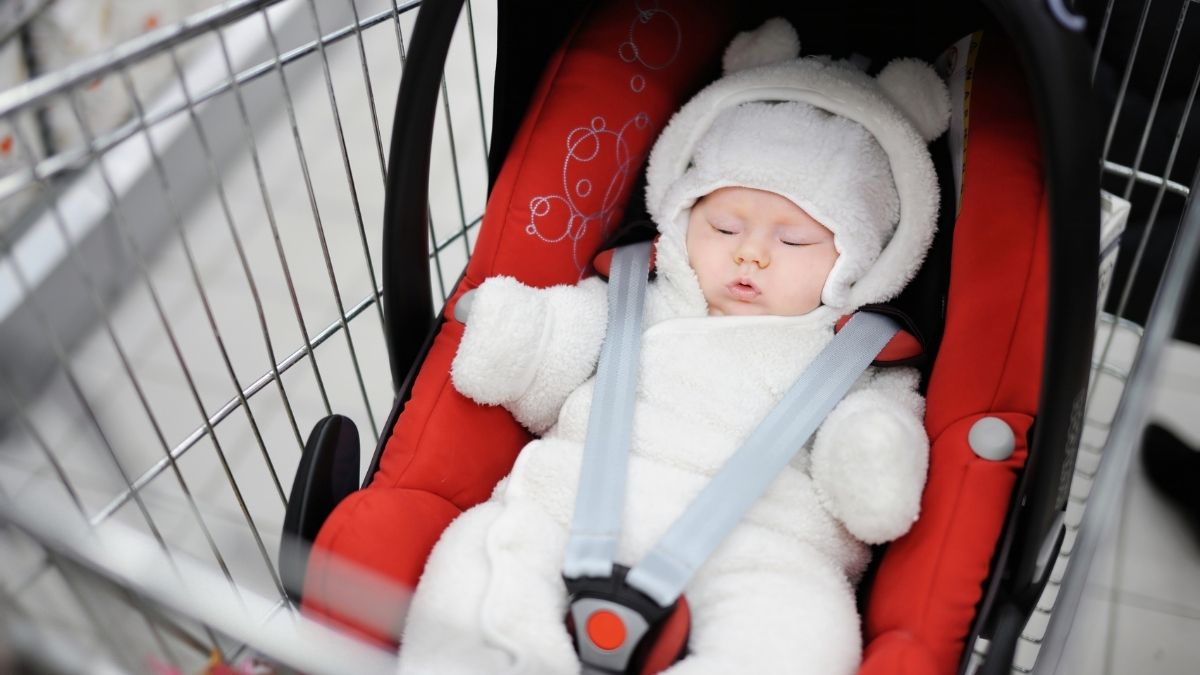 baby in shopping trolley cart