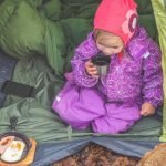 child camping in a tent