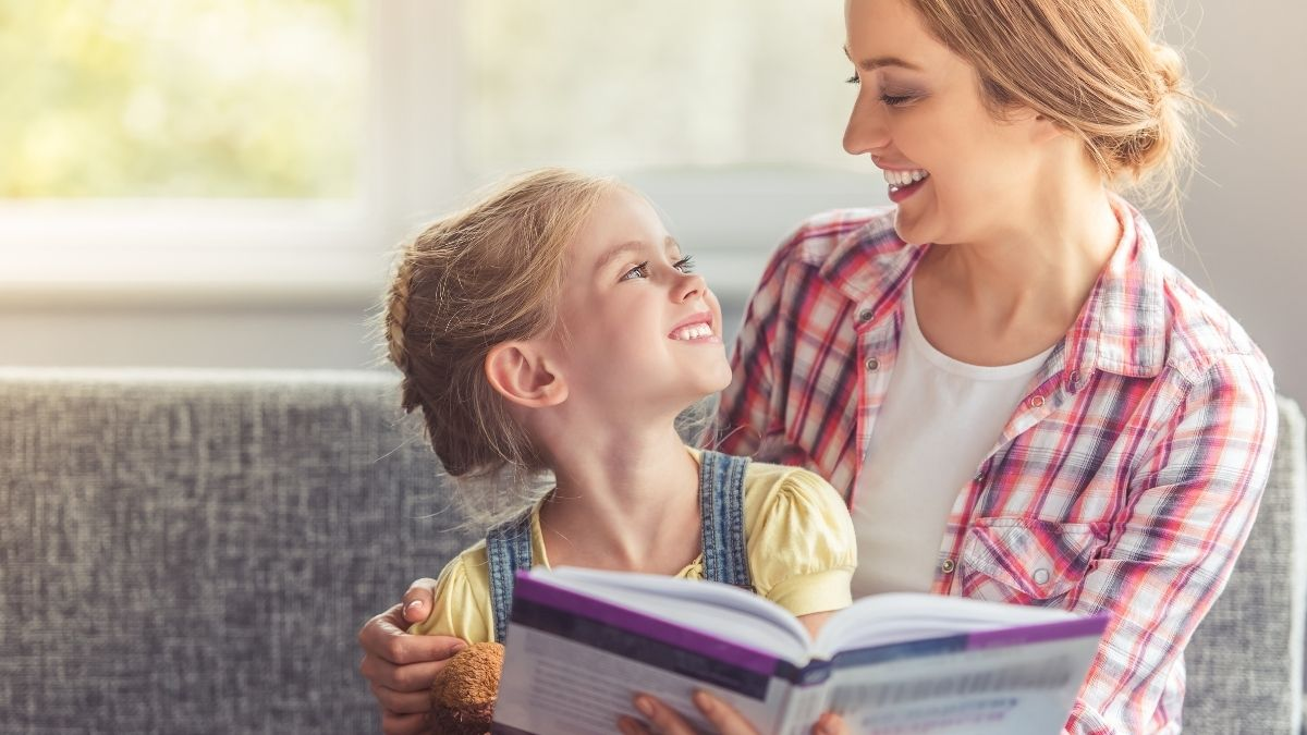 mom talking to her daughter reading a book
