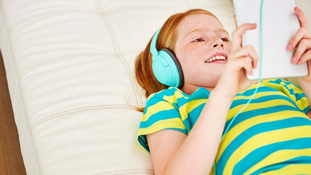 girl laying down screen time smiling