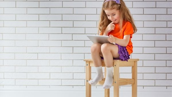 girl watching tablet - screen time