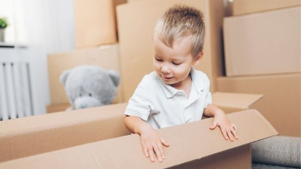toddler playing in empty box