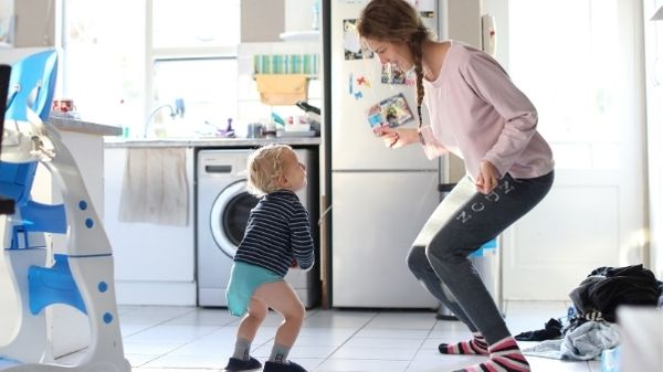 toddler dancing in kitchen with mom