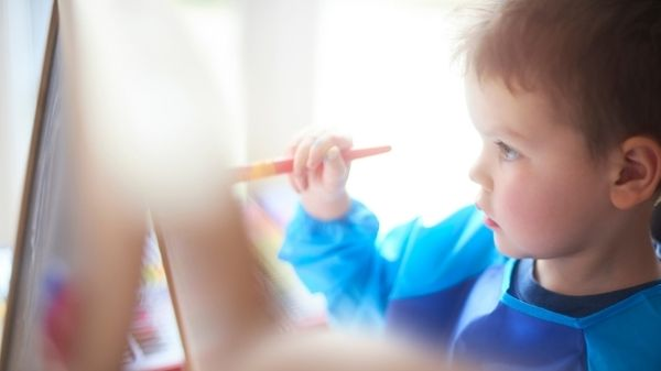 toddler painting a picture