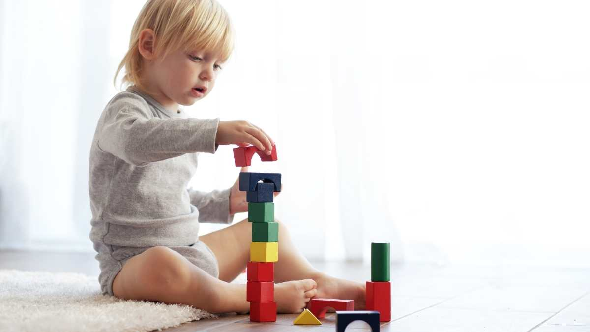 toddler playing calmly with toys