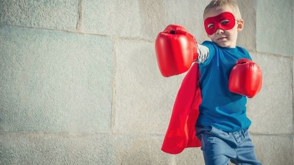child with mask and boxing gloves on