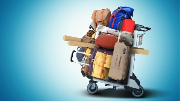 overpacked suitcases on trolley