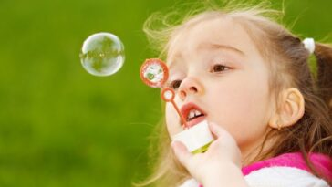 toddler blowing bubbles