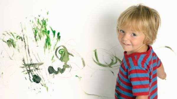 toddler painting the wall