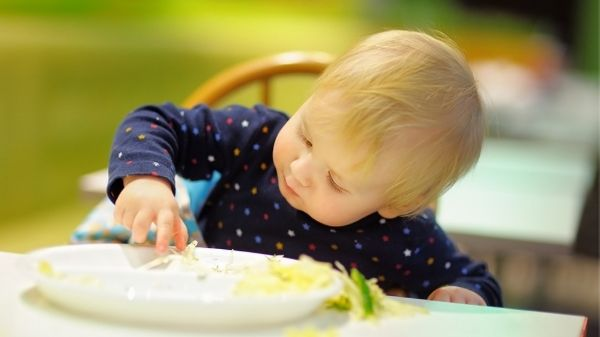toddler playing with food