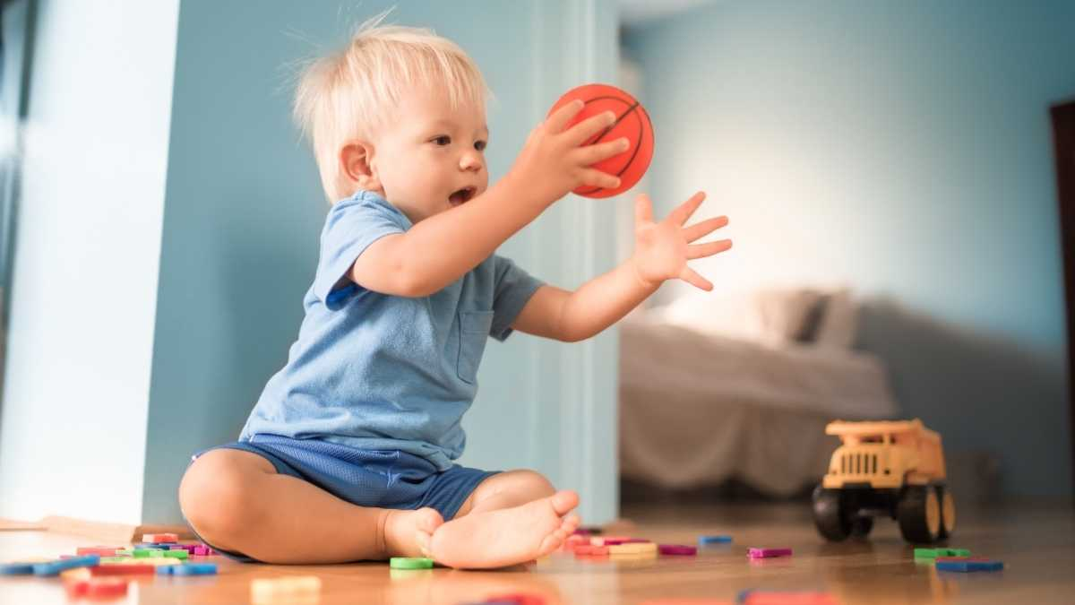 toddler solo play with ball and digger