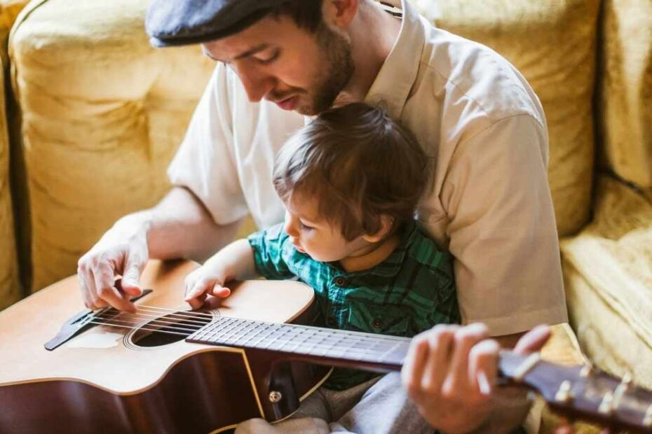 dad playing guitar with his toddler