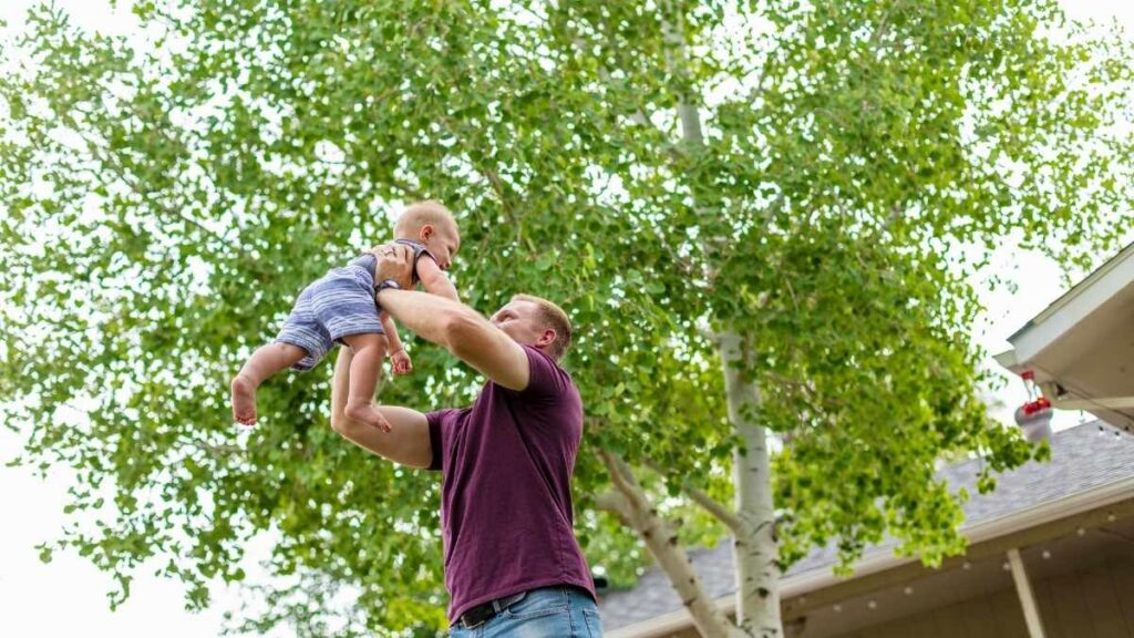 dad playing with toddler outside (1)