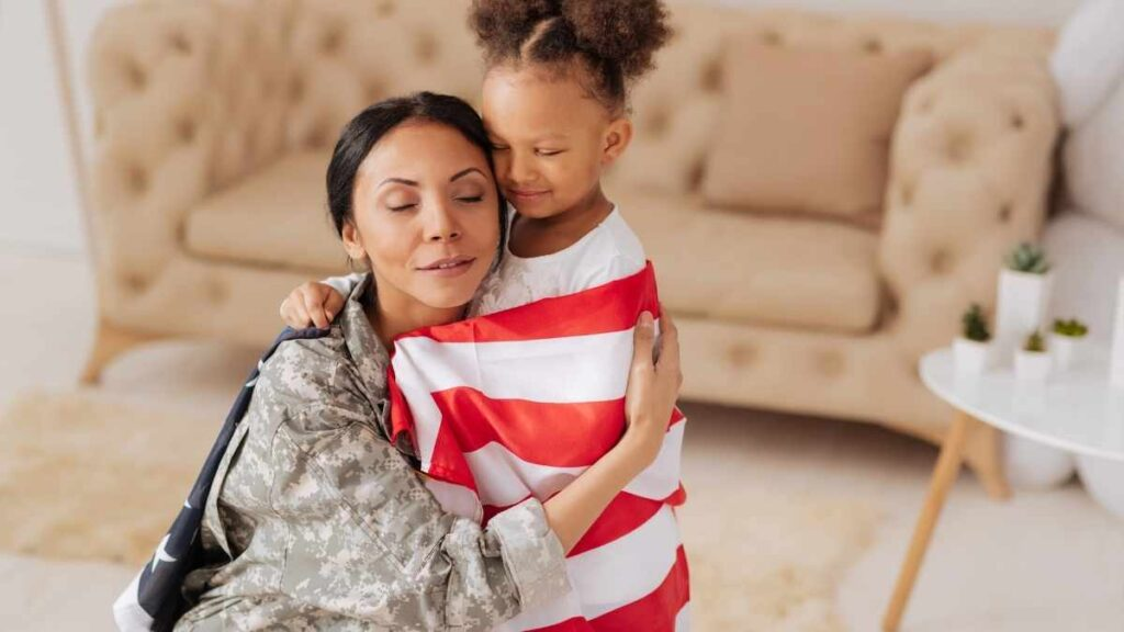 little girl attached to mom wearing us flag